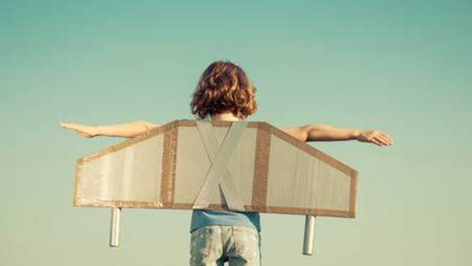 Child with cardboard wings on her back
