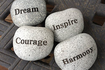 Rocks with dream, courage, inspire and harmony written on them