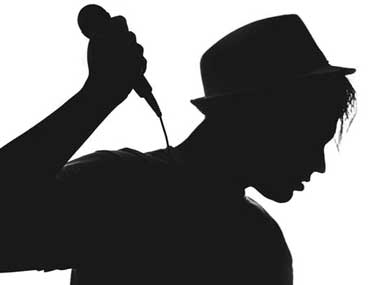 Silhouette of girl with microphone