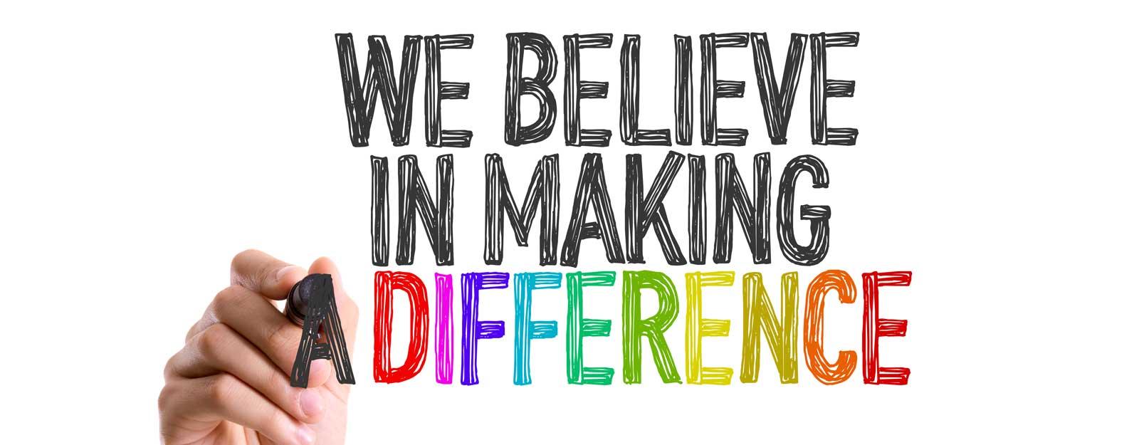 We believe in making a difference written in marker