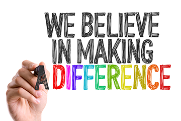 We believe in making a difference written in marker